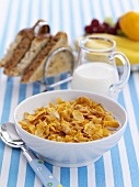 Cornflakes with milk, fruit and toast