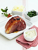 Roast ham with sauce and side dishes (Christmas)