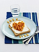Bread with cream cheese and alphabet pasta for children