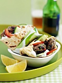 Pita bread filled with lamb, cucumbers and tomatoes