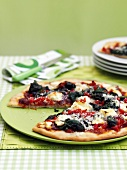 Vegetable pizza, cut