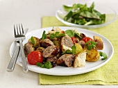 Fried sausage with potatoes and cherry tomatoes