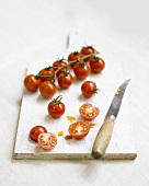 Cherry tomatoes on the vine and cut in half