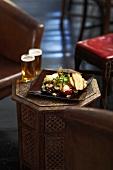 Mezze platter with two beers