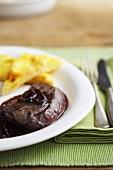 Venison steak in a red wine sauce