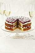 Sponge cake with raspberry jam and raspberries