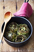 Artichokes with cheese and butter in a pan