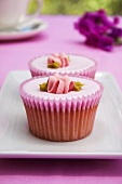 Pink cupcakes with sugar flowers