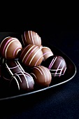 Several chocolates on plate