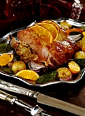 Roast ham with apple and apricot stuffing and orange crust