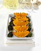 Toasted orange wedges and sage leaves