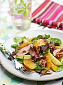 Spinach and orange salad with duck breast