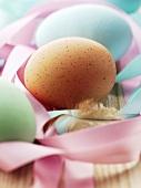 Hens' eggs among gift ribbons