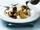 Pancake with poached pear and chocolate sauce