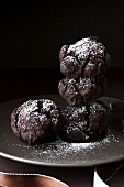 Chocolate biscuits dusted with icing sugar