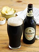 Glass of Guinness with bottle