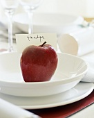 Christmas place-setting with red apple and place card