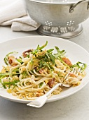 Spaghetti with crabmeat, rocket, pancetta and breadcrumbs