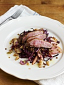 Duck breast on red cabbage salad with lentils, pear and walnuts
