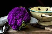 Purple cauliflower on wooden table