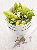 Romaine lettuce with peas, feta cheese and onions