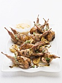 Roasted quail with herbs, lemon and aioli