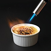 Caramelising crème brûlée with blowtorch