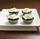 Four cupcakes on square plate