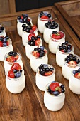 Jars of yoghurt with fresh berries