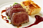 Venison fillet with beetroot sauce and potato gratin