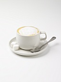 Cappuccino with sugar cubes