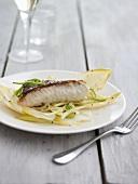 Haddock with salad, glass of wine