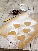 Outlines of heart-shaped biscuits in icing sugar