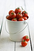 A bucket full of cherry tomatoes