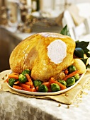 Roast turkey with carrots and Brussels sprouts (a slice removed)