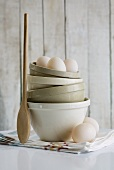 Stacked ceramic basins, duck eggs and wooden spoon
