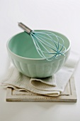 Blue mixing bowl with whisk