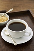 Black instant coffee in cup and saucer