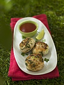 Fish cakes with ketchup