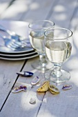 Two glasses of white wine on wooden table