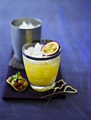 Passion fruit cocktail with ice cubes