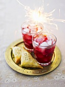 Pomegranate drinks with samosas and sparkler