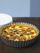 Cheese, spinach and tomato quiche in quiche dish