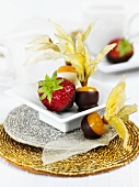 Chocolate-dipped strawberries and physalis