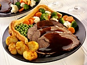 Roast beef with Yorkshire pudding (England)