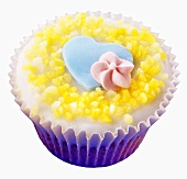 Cupcake with a blue heart and a sugar flower