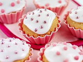 Fairy cakes with pink sugar pearls