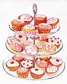Lots of fairy cakes, decorated in pink and white, on a cake stand