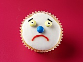 Cupcake with a sad face