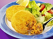 Breaded fish burger with salad